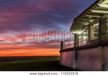 The Veronica sun bay of Napier New Zealnd with a very colorful dawn sky. poster