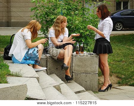 Yekaterinburg, Russia - May 26, 2010: Three Young Girls Drink Beer In The City Park
