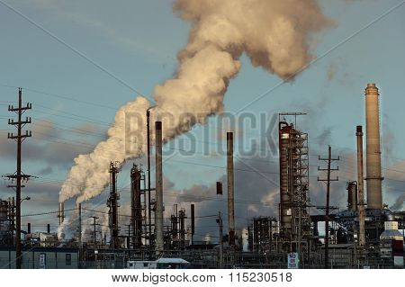 Gases coming out of smoke stacks at oil refinery