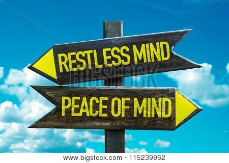 Restless Mind - Peace of Mind signpost with sky background