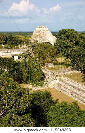 Landscape View Of Uxmal Archeological Site With Pyramids And Ruins