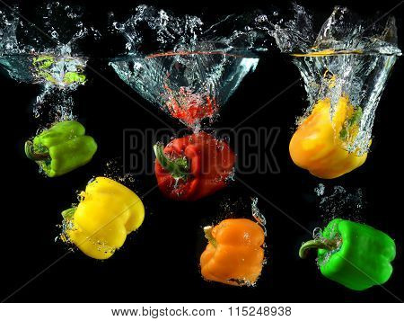 Bell Peppers Droping In To Clean Water