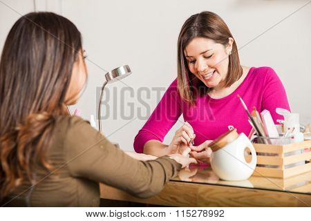 Manicurist Working With A Customer