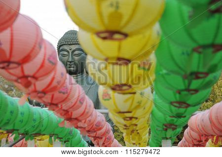 Focusing on Buddha's head with color lanterns at Gakwonsa Temple, South Korea