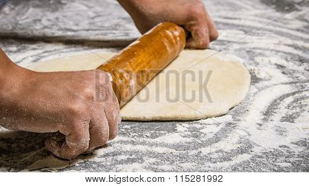 Preparation Of The Dough . The Dough Rolling The Women's Hands.