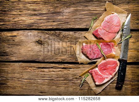 Fresh Stake From Raw Meat And Spices And Chopping Knife.