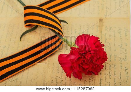 Carnations, St. George Ribbon And An Old Letter