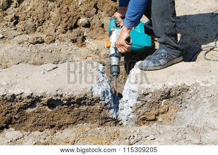 Worker Hammer Smashes The Concrete Foundation