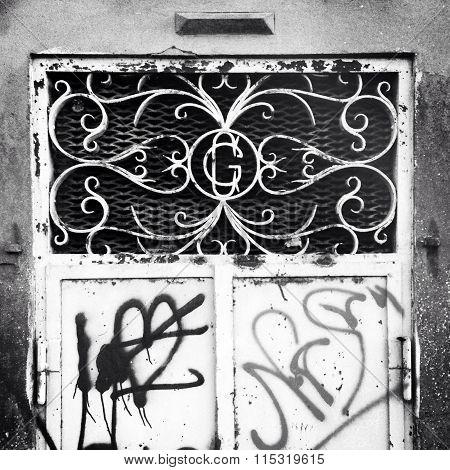 Vintage wrought iron door with spraypaint