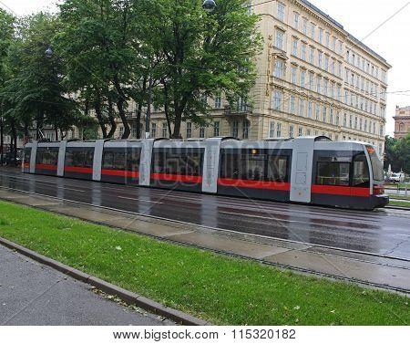Red articulated tram