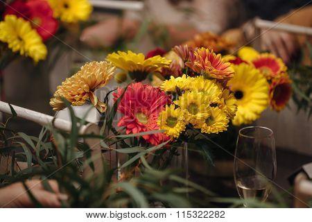 Female hands making a bouquet