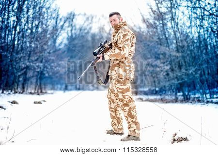 Army Sniper During Military Operation Using A Professional Rifle On A Cold Winter Day