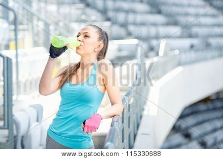 Fitness Concept - Young Woman Drinking Water During Workout, Training. Cross Fit Workout On Stairs,