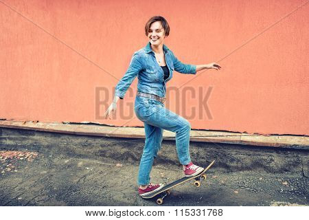 Artsy Portrait Of A Brunette Cute Girl On A Skateboard, Laughing And Having A Good Time. Healthy Con