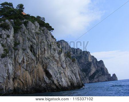 Beach sea shore with rocks and waves from Amalfi region in Italy