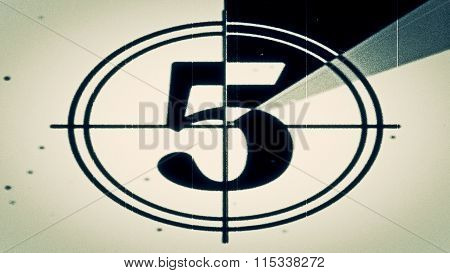 Noisy Film leader countdown frame showing the number five.