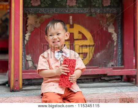 Asian Baby Boy Hold Red Envelope Or Ang-pow .