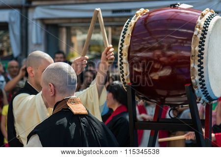 Two Japanese Taiko Drummers During Traditional Show