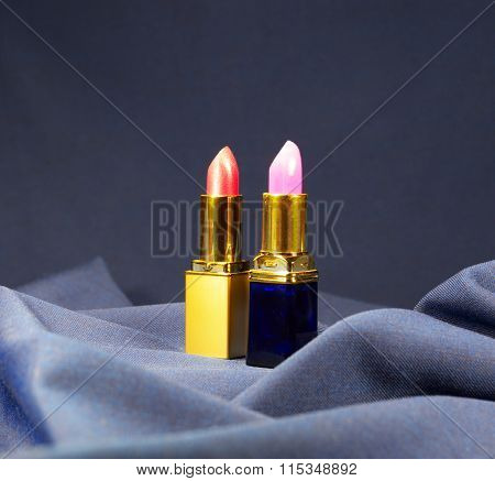 A Set Of Lipstick On Velvet Cloth