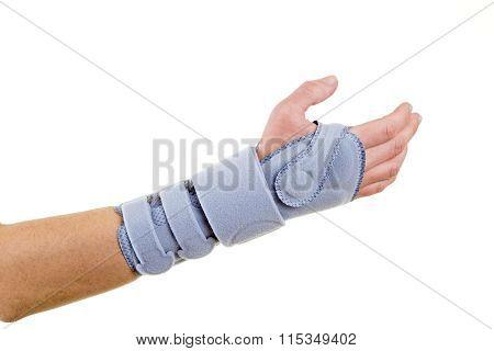 Man Wearing Supportive Wrist Brace In Studio
