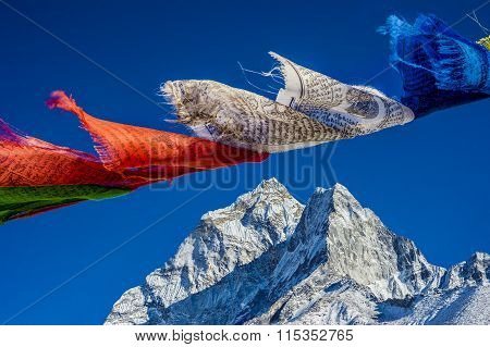 Prayer Flags In The Himalayas With Ama Dablam Peak In The Background