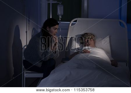 Caregiver Sitting By Patient