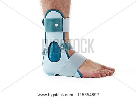 Man Wearing Ankle Support Cast In White Studio