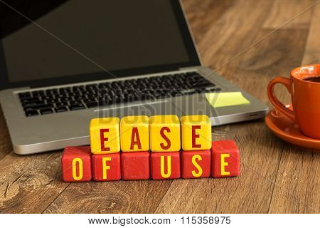 Ease of Use written on a wooden cube in a office desk