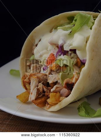 donner kebab  on a white plate close up  isolated black