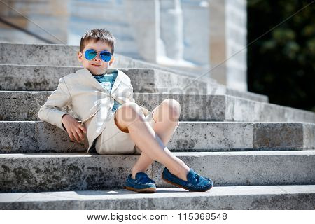 Little boy in a nice suit and glasses. Back to school. Children portrait