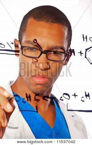 Scientist works on an equation