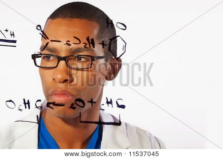 Doctor working on an equation