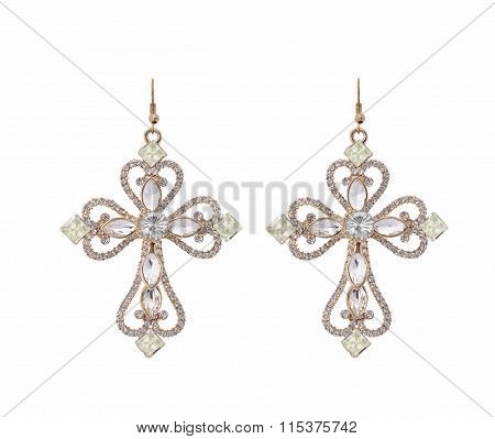 Earring the shape of a cross with zircons on white background with zircons on white background