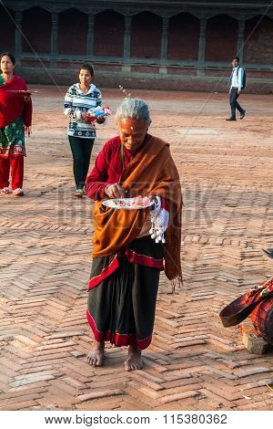 Elderly Woman - Newar Hurry To Make A Religious Ritual Puja