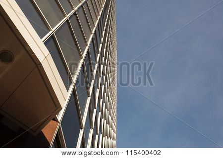 Low Angle View Of Office Building Next To Sky
