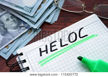 HELOC written on a notebook.