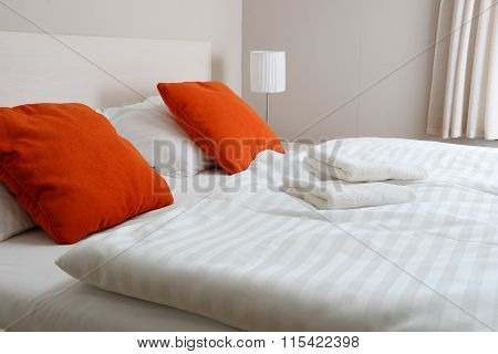 Double bed in hotel room. Accommodation . poster