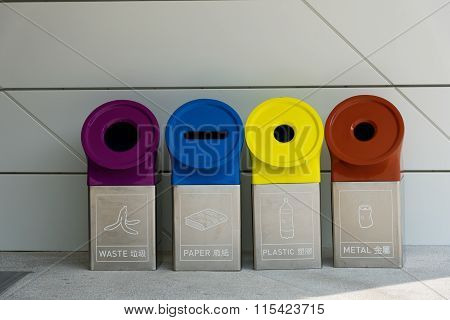 Four Different Trashcans For Separate Waste Collection. Trashcans Have Different Colours And Shapes
