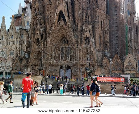 Barcelona, Spain - May 17, 2014: Tourists Walk From The Sagrada Familia.