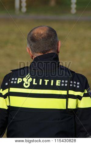 Police officer - Dutch national police uniform - backside