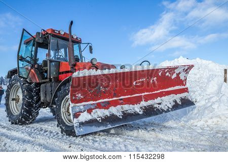 Big Red Snow Plow On Snowy Road