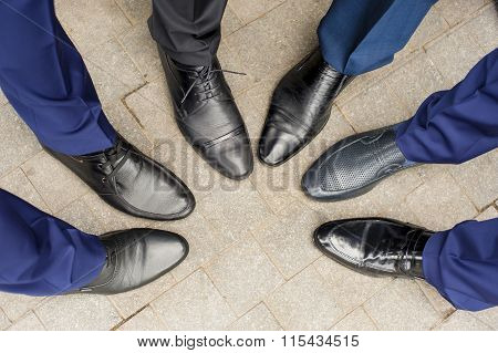 The shoes of the groom's friends.