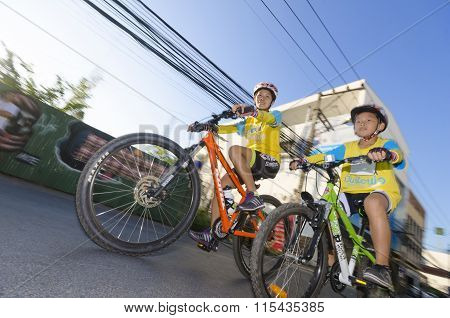 Boy And Mother At Bike For Dad