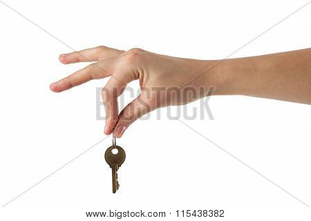 Close up view of hand holding key to a dream house isolated on w