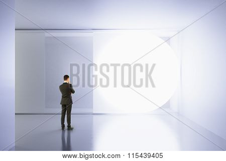A Man Stands In An Empty White Room With Copy Space