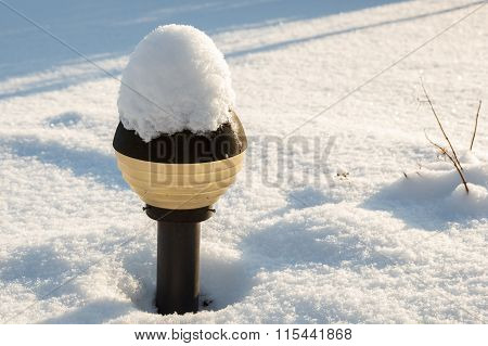 Snow covered lamp post