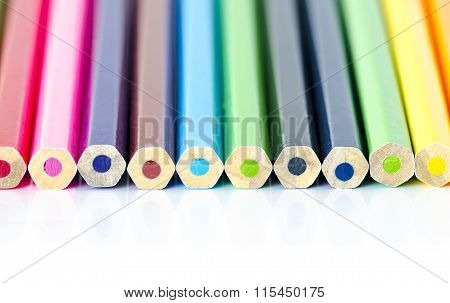 Many Colored Pencils Aligned With Back On White Background