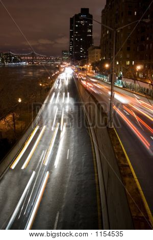 urban traffic at night on fdr drive in new york city poster