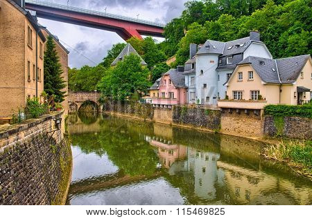 River with houses and bridges in Luxembourg, Benelux, HDR