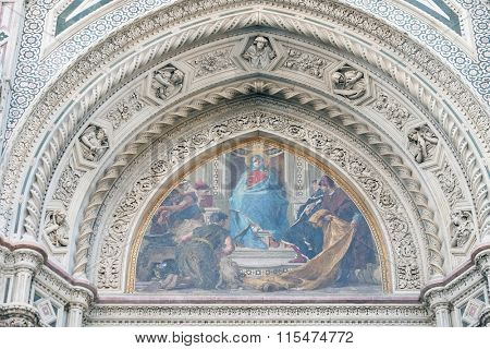 FLORENCE, ITALY - JUNE 05: Mary surrounded by Florentine Artists, Merchants and Humanists, Right Portal of Cattedrale di Santa Maria del Fiore, Florence, Italy on June 05, 2015